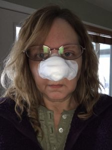 Me with bandaged nose